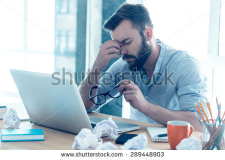 stock-photo-feeling-exhausted-frustrated-young-beard-man-massaging-his-nose-and-keeping-eyes-closed-while-289448903