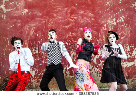 stock-photo-four-mimes-standing-in-awe-at-the-background-of-a-red-wall-383287525