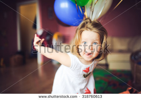 stock-photo-portrait-of-little-baby-girl-at-home-on-the-day-of-birth-in-a-dress-with-colorful-balls-smiles-and-318760613