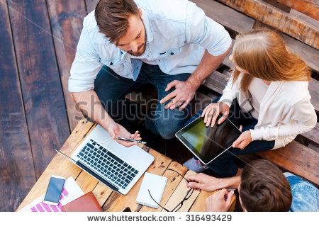 stock-photo-they-can-work-anywhere-top-view-of-three-young-people-working-together-while-sitting-outdoors-316493429